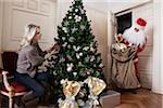 Santa Claus Bringing Gifts to Woman