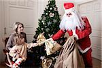 Santa Claus Handing Gift to Boy