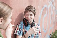 Young Teens Smoking Cigarettes Stock Photo - Premium Rights-Managednull, Code: 700-03849060