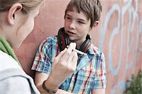 Young Teens Smoking Cigarettes Stock Photo - Premium Rights-Managednull, Code: 700-03849061