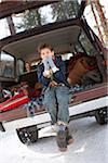 Boy Sitting on Tailgate of Vintage 4x4 Vehicle in Winter Stock Photo - Premium Rights-Managed, Artist: Ty Milford, Code: 700-03849319