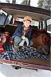 Boy Crouching Inside Rear of Vehicle Stock Photo - Premium Rights-Managed, Artist: Ty Milford, Code: 700-03849321