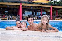 Family in Swimming Pool, Reef Playacar Resort and Spa, Playa del Carmen, Mexico Stock Photo - Premium Royalty-Freenull, Code: 600-03849555