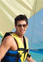 Man on Sailboat, Reef Playacar Resort and Spa, Playa del Carmen, Mexico Stock Photo - Premium Royalty-Freenull, Code: 600-03849556