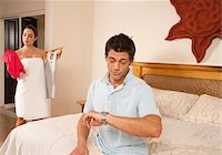 Man Checking Watch while Woman gets Ready, Reef Playacar Resort and Spa, Playa del Carmen, Mexico Stock Photo - Premium Royalty-Freenull, Code: 600-03849674