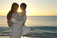 Couple at Beach at Sunset, Reef Playacar Resort and Spa, Playa del Carmen, Mexico Stock Photo - Premium Royalty-Freenull, Code: 600-03849686