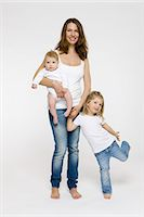 Mother and children standing together Stock Photo - Premium Royalty-Freenull, Code: 649-03857549
