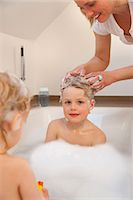 Mother washing son's hair in bathtub Stock Photo - Premium Royalty-Freenull, Code: 649-03857883