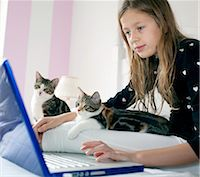 preteen girl pussy - Girl using laptop with kittens Stock Photo - Premium Royalty-Freenull, Code: 649-03858045