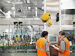 Factory workers in bottling plant Stock Photo - Premium Royalty-Free, Artist: Ikon Images, Code: 649-03858202