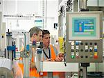 Factory workers in bottling plant Stock Photo - Premium Royalty-Free, Artist: Ikon Images, Code: 649-03858205