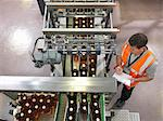 Factory worker in bottling plant Stock Photo - Premium Royalty-Free, Artist: Ikon Images, Code: 649-03858209