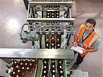 Factory worker in bottling plant Stock Photo - Premium Royalty-Freenull, Code: 649-03858210