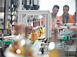 Wine bottles in bottling machine Stock Photo - Premium Royalty-Freenull, Code: 649-03858212