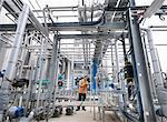 Worker with machinery in bottling plant Stock Photo - Premium Royalty-Freenull, Code: 649-03858241