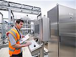 Worker with machinery in bottling plant Stock Photo - Premium Royalty-Freenull, Code: 649-03858243