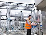 Worker with machinery in bottling plant Stock Photo - Premium Royalty-Freenull, Code: 649-03858244