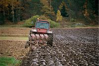 plow - Tractor ploughing crops in farmland Stock Photo - Premium Royalty-Freenull, Code: 6102-03859077