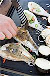 Person cooking fish pieces on barbecue grill Stock Photo - Premium Royalty-Free, Artist: Ruslan_Kokarev, Code: 6102-03859556