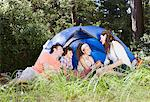 Family sitting outside tent Stock Photo - Premium Royalty-Freenull, Code: 635-03859696