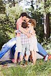 Family hugging outside tent Stock Photo - Premium Royalty-Freenull, Code: 635-03859699