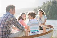 side view of person rowing in boat - Family in rowboat on lake Stock Photo - Premium Royalty-Freenull, Code: 635-03859748