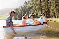 side view of person rowing in boat - Family in rowboat on lake Stock Photo - Premium Royalty-Freenull, Code: 635-03859766