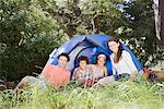 Family relaxing outside tent Stock Photo - Premium Royalty-Freenull, Code: 635-03859771