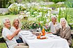 Senior couples drinking wine at table in garden Stock Photo - Premium Royalty-Freenull, Code: 635-03859852