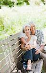 Senior couple hugging on bench Stock Photo - Premium Royalty-Freenull, Code: 635-03859876