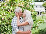 Senior couple kissing in garden Stock Photo - Premium Royalty-Freenull, Code: 635-03859895