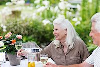 Senior couple drinking wine at table in garden Stock Photo - Premium Royalty-Freenull, Code: 635-03859936