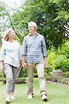 Senior couple walking in garden Stock Photo - Premium Royalty-Freenull, Code: 635-03859945
