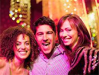 Portrait of friends at nightclub Stock Photo - Premium Royalty-Freenull, Code: 635-03860061