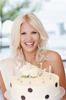 Portrait of woman holding birthday cake Stock Photo - Premium Royalty-Freenull, Code: 635-03860069