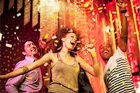 Friends dancing at nightclub Stock Photo - Premium Royalty-Freenull, Code: 635-03860076