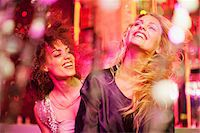 Friends dancing in nightclub Stock Photo - Premium Royalty-Freenull, Code: 635-03860110