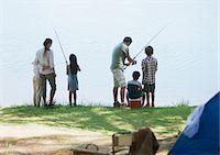 Family fishing near campsite Stock Photo - Premium Royalty-Freenull, Code: 635-03860175