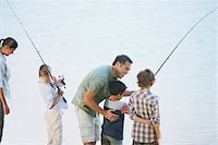 Family fishing in lake Stock Photo - Premium Royalty-Freenull, Code: 635-03860179