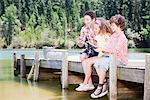 Family fishing off dock Stock Photo - Premium Royalty-Freenull, Code: 635-03860194
