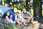 Family sitting outside tent at campsite Stock Photo - Premium Royalty-Freenull, Code: 635-03860195