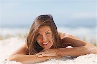 Woman laying on beach Stock Photo - Premium Royalty-Freenull, Code: 635-03860293