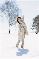 Teenage Girl Walking In Snow Stock Photo - Premium Rights-Managednull, Code: 859-03860638