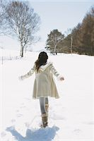 Girl Hanging Out In Snow Stock Photo - Premium Rights-Managednull, Code: 859-03860654