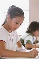 Japanese Schoolgirl Writing Stock Photo - Premium Rights-Managednull, Code: 859-03860804