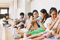 Children Sitting In School Corridor Stock Photo - Premium Rights-Managednull, Code: 859-03860865