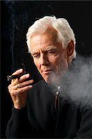 Man Smoking Cigar Stock Photo - Premium Royalty-Freenull, Code: 600-03865038