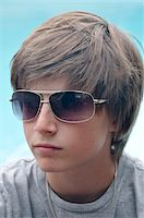 Portrait of Boy wearing Sunglasses Stock Photo - Premium Royalty-Freenull, Code: 600-03865107