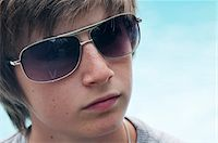 Portrait of Boy wearing Sunglasses Stock Photo - Premium Royalty-Freenull, Code: 600-03865127