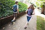 Boy and Girl Walking Home from School, Portland, Oregon Stock Photo - Premium Royalty-Free, Artist: Ty Milford, Code: 600-03865191